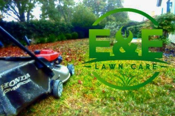 E&E Logo next to push mower in the fall