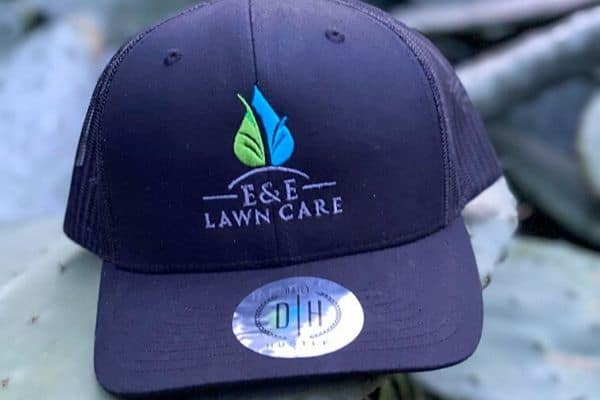 Local E&E Lawn Care hat in blue with sticker