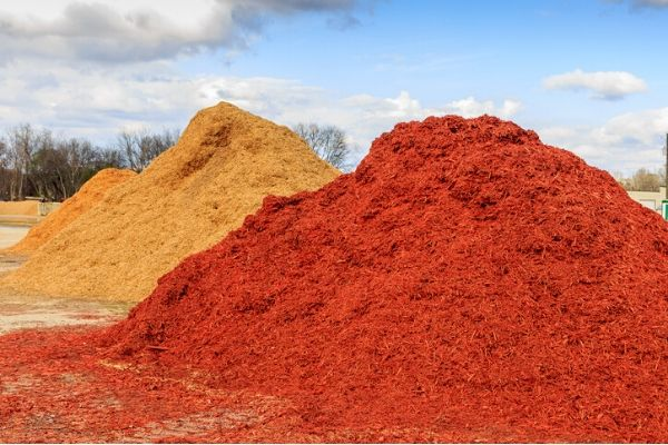 Two piles of red and brown mulch